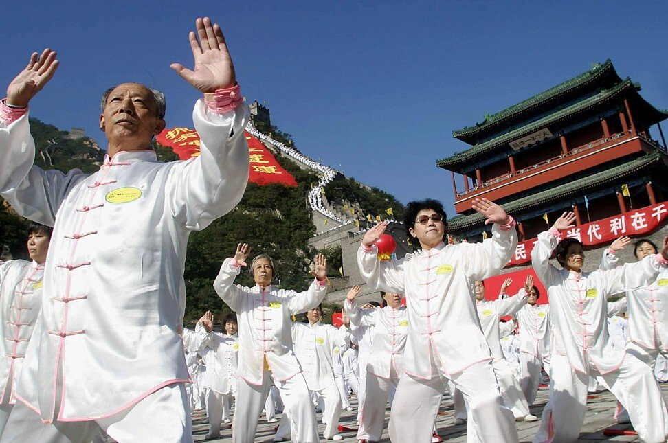 Tai chi practitioners show off their skills. The sport was born in the village of Chenjiagou, in Henan province, in the mid-17th century. Photo: AFP
