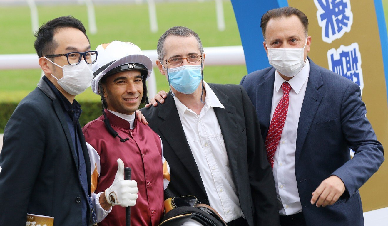 Jockey Joao Moreira and trainer Caspar Fownes (right) celebrate Forte's win with connections.