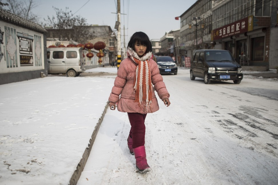 """A girl leaves her school at Tuntou village, on the outskirts of Shijiazhuang, Hebei province. Style-conscious Chinese youth are shedding long johns in the belief they are """"tasteless"""" and """"old-fashioned"""". Photo: AFP"""