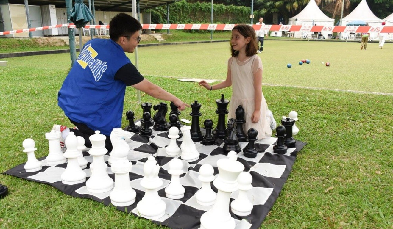 A giant chess board is set up on the grounds of a local club in Hong Kong. Photo: ActiveKids