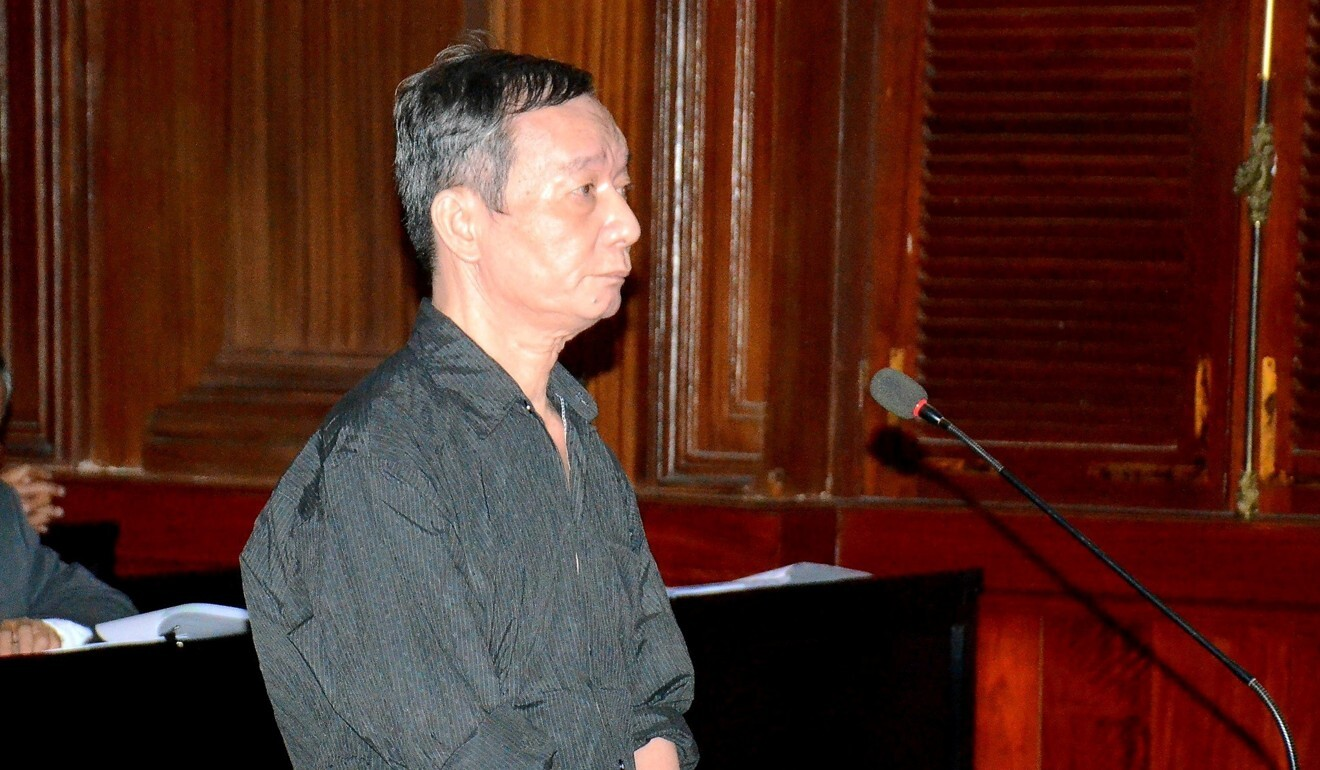 Nguyen Tuong Thuy stands in the dock during his trial. He received an 11-year prison sentence. Photo: Reuters