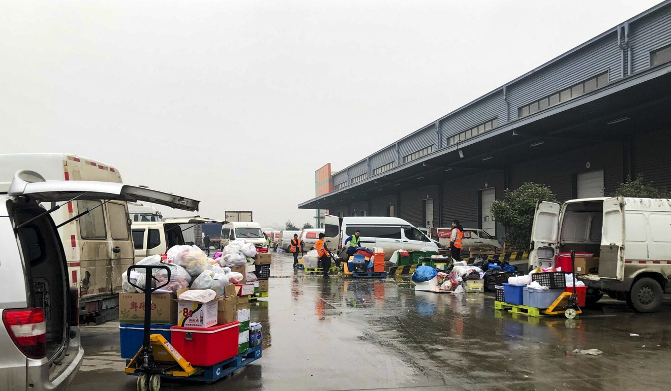 At the busy warehouse of Chengxin Youxuan, drivers load up their vans with goods before delivering to communities in Nanchang, 2021. Photo: SCMP/ Orange Wang