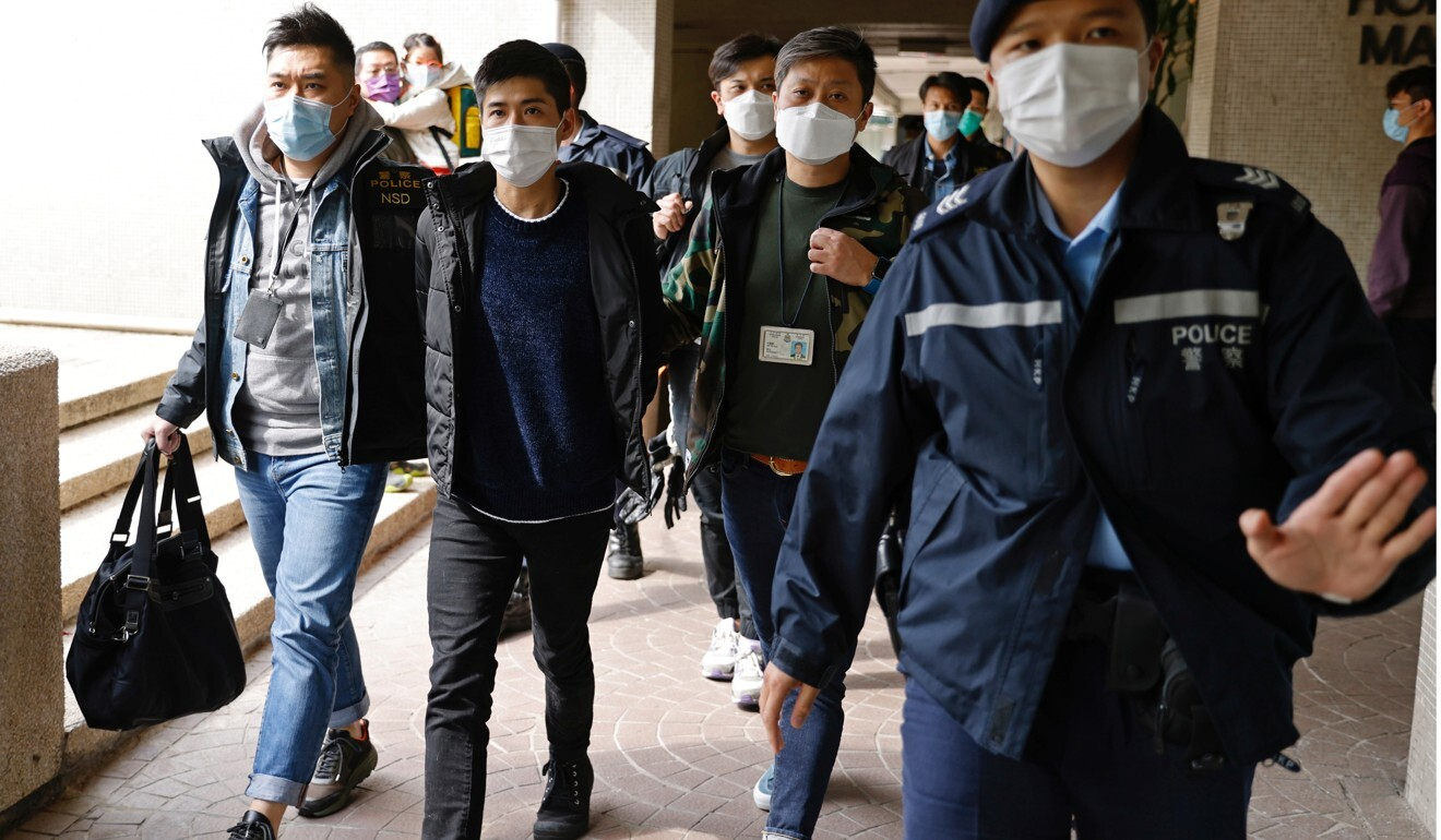 Activist Lester Shum is taken away by police on Wednesday morning. Photo: Reuters