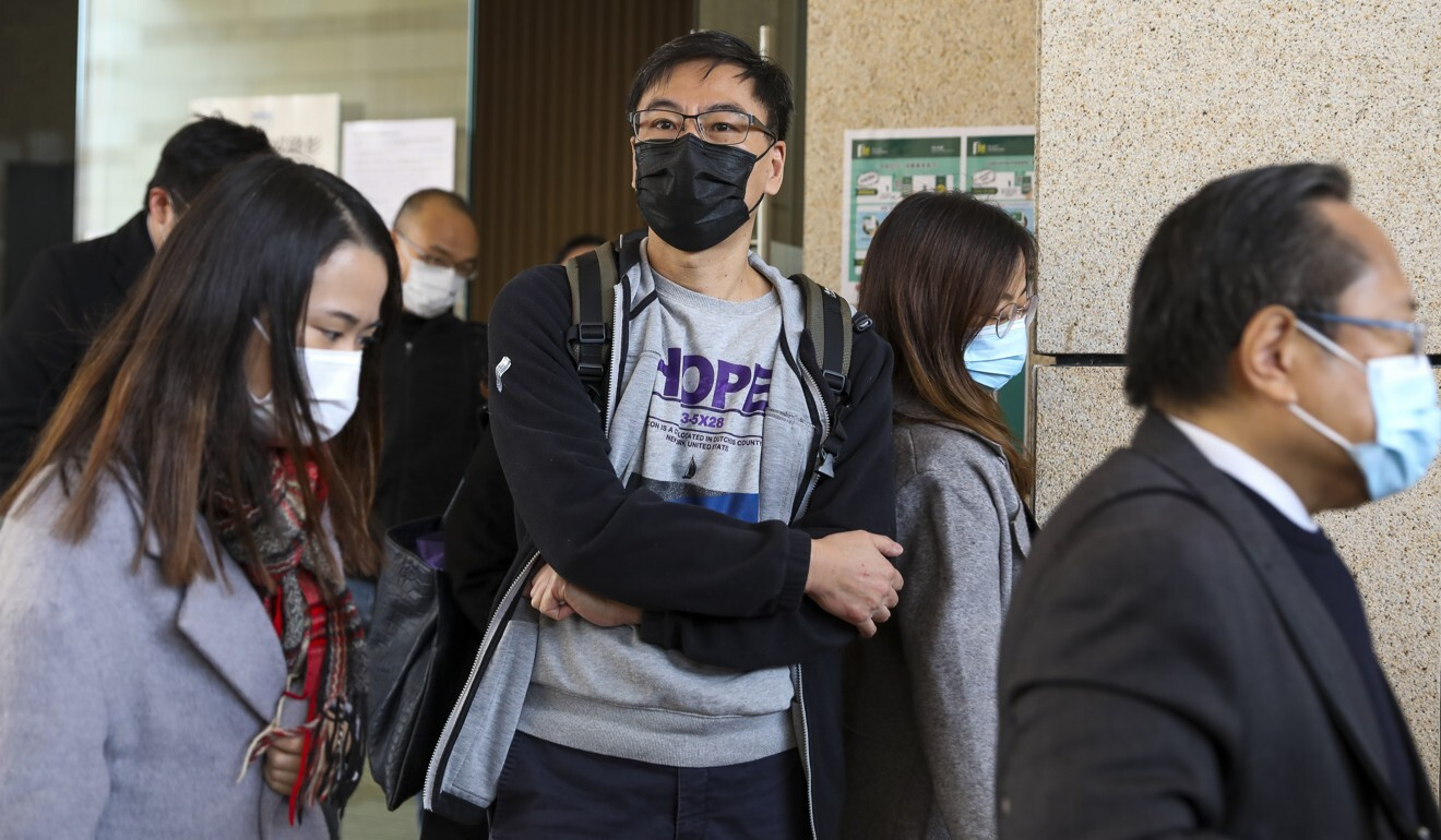 Chow Tak-ming, father of Alex Chow Tsz-lok, is seen outside West Kowloon Court on Thursday. Photo: Nora Tam