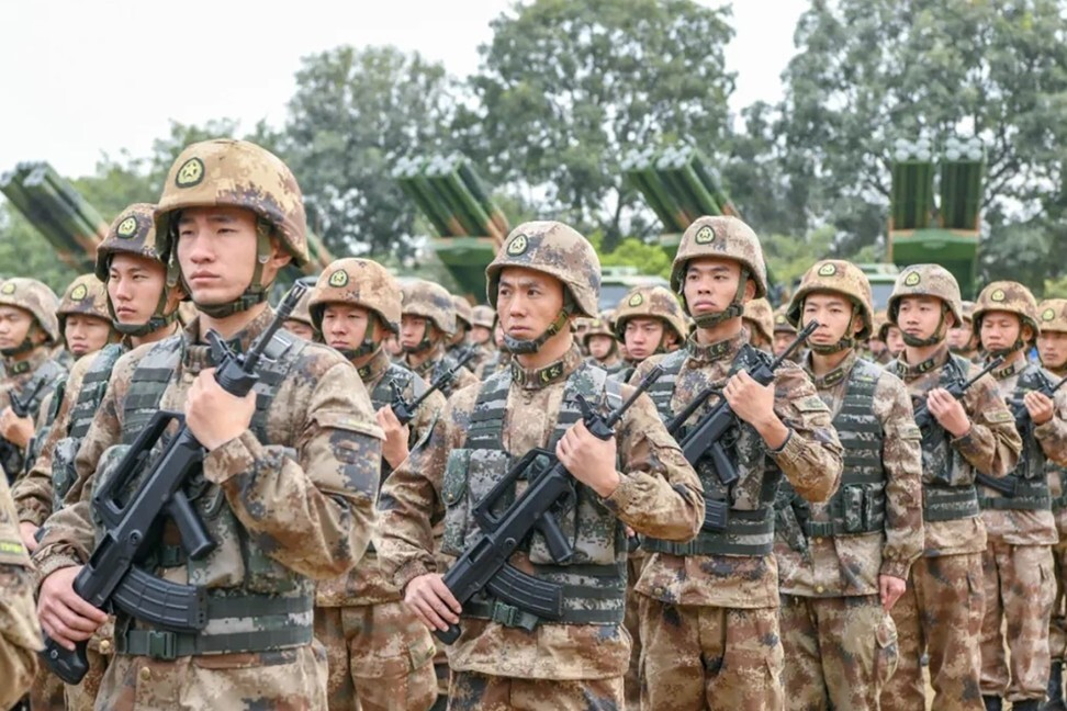 Images posted to social media show the PCL-191 – pictured behind the troops – in the first public display since its debut in 2019. Photo: Weibo