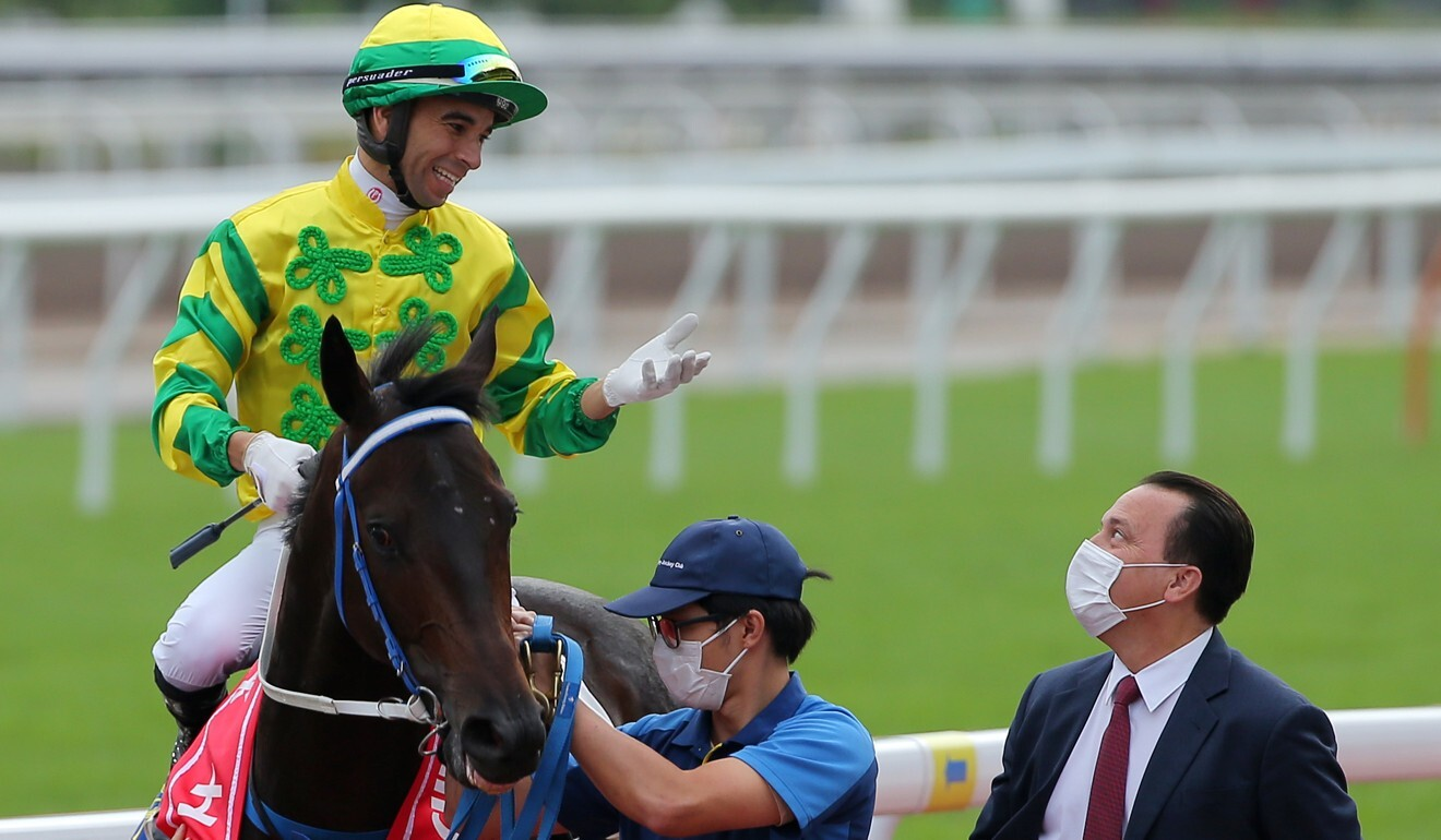 Jockey Joao Moreira chats to trainer Caspar Fownes after a Sky Darci win.