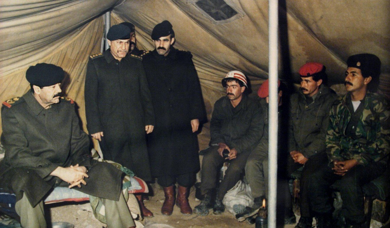 Many Iraqi troops, seen here being visited by Saddam Hussein (left) after their invasion of Kuwait in 1990, were veterans of the war with Iran. Photo: AFP