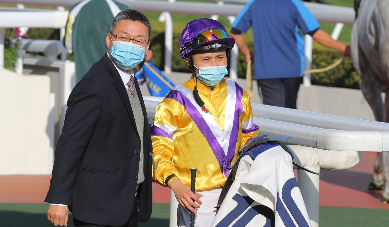 Matthew Poon with trainer Francis Lui after Glorious Dragon's victory at Sha Tin on Sunday.