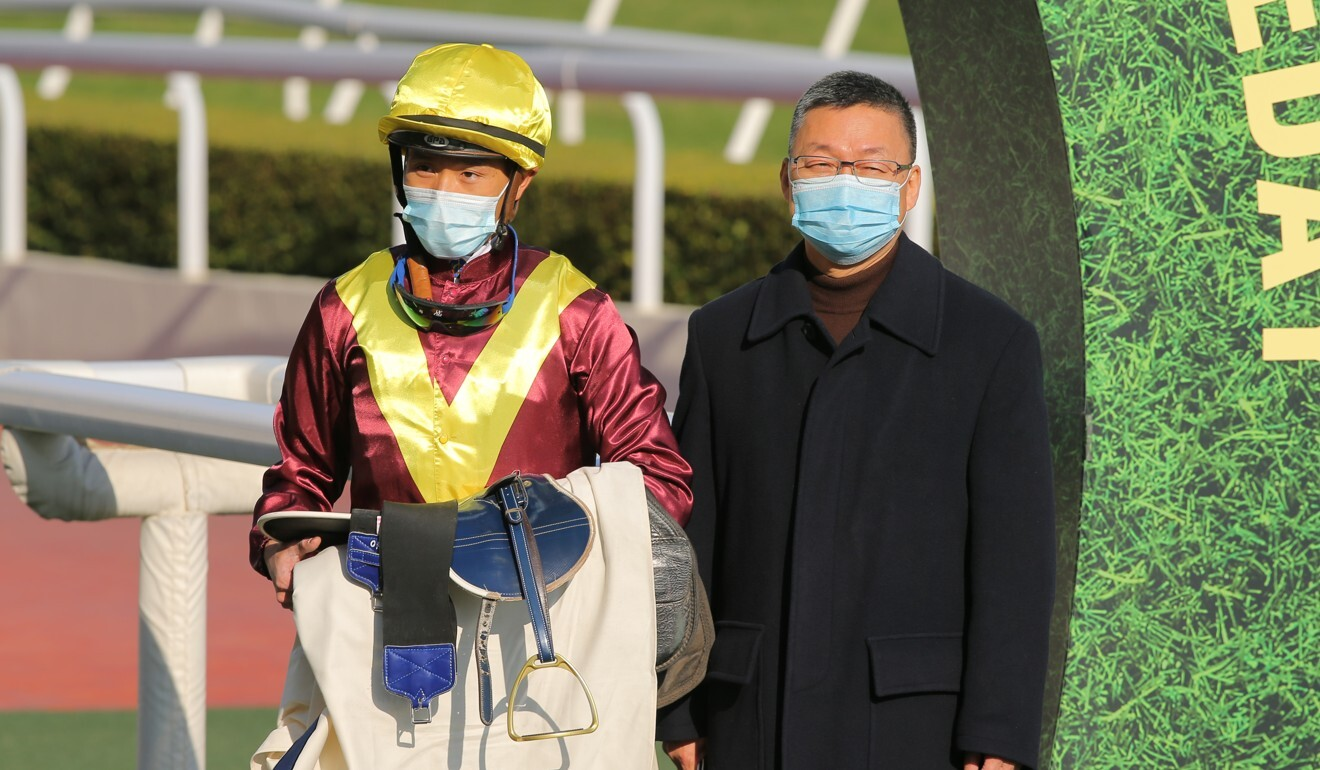 Jockey Vincent Ho and trainer Francis Lui celebrate a Sea Of Life victory.