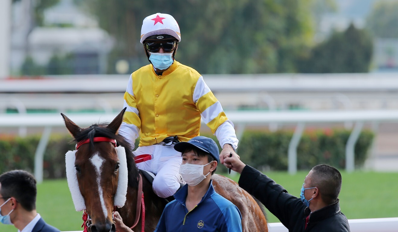 Christophe Soumillon celebrates his win aboard Decisive Action with trainer Danny Shum. Photo: Kenneth Chan