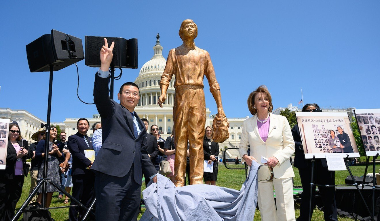 Pro-democracy activist Yang Jianli stands with House Speaker Nancy Pelosi at a ceremony to mark the 30th anniversary of the Tiananmen Square crackdown, in June 2019 in Washington. Photo: Handout