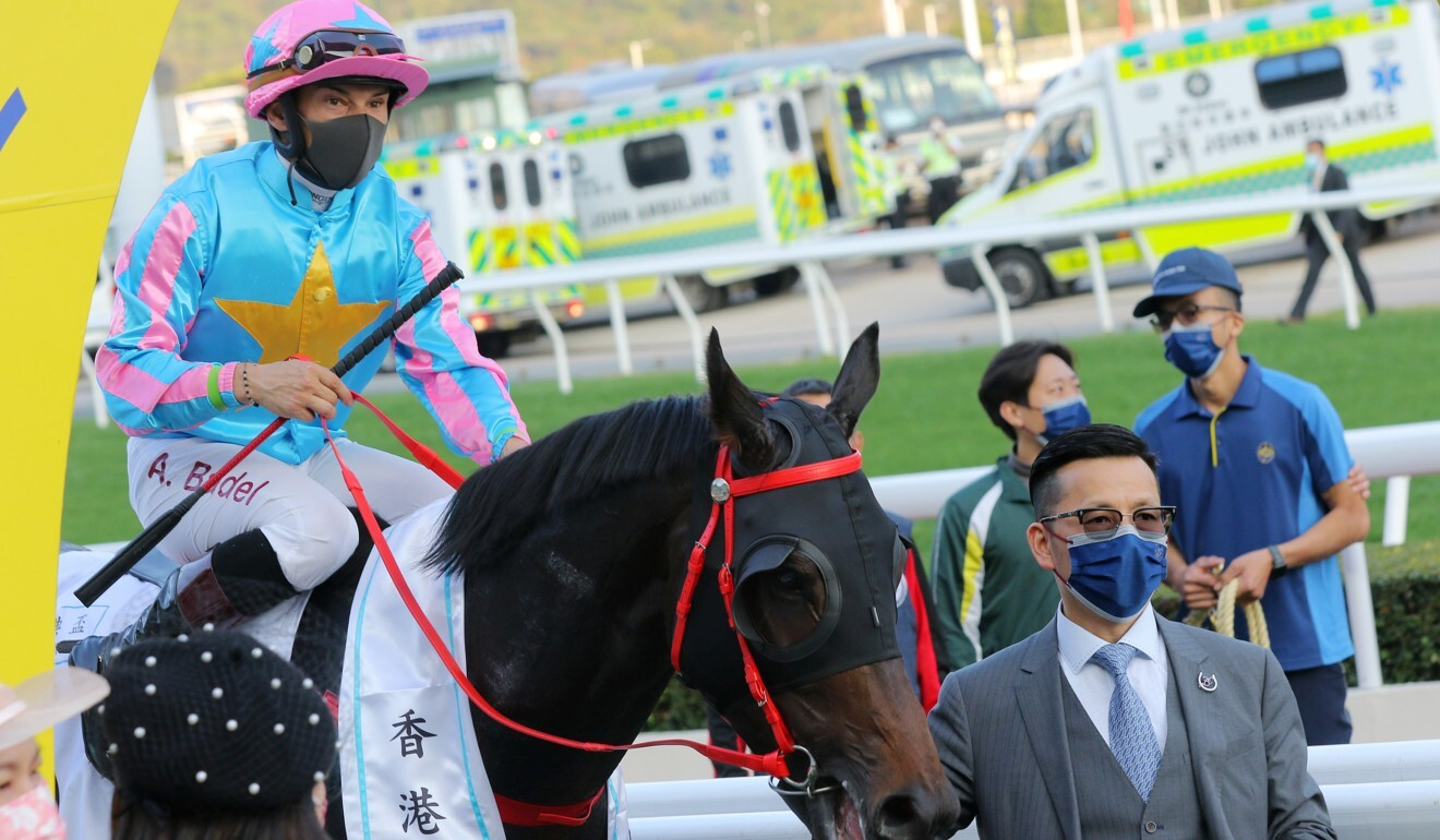Jockey Alexis Badel and trainer Frankie Lor after Healthy Happy's victory.