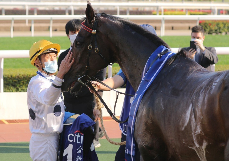Vincent Ho gives a sweaty Golden Sixty a pat after the Gold Cup.