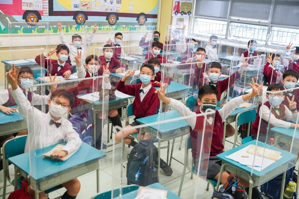 Ying Wa Primary School lessons restart with dividers in place. Photo: Winson Wong