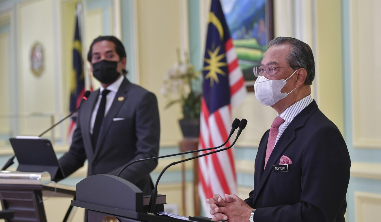 Prime Minister Muhyiddin Yassin (right) and science minister Khairy Jamaluddin during the launch of the National Covid-19 Immunisation Programme Handbook. Photo: DPA