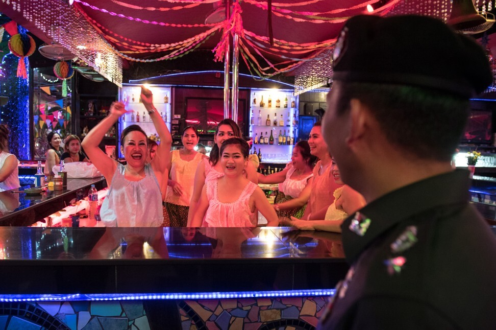 Women hostesses at a bar in Pattaya. Thailand's legal system offers few safeguards for women involved in such jobs. Photo: AFP