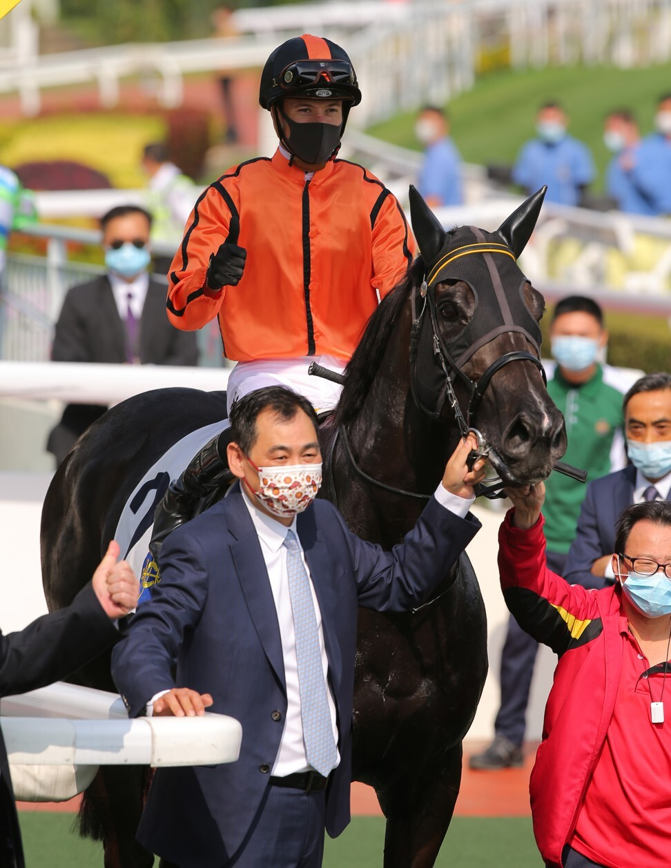 Michael Chang celebrates the win of Simply Spectacular at Sha Tin on Sunday.