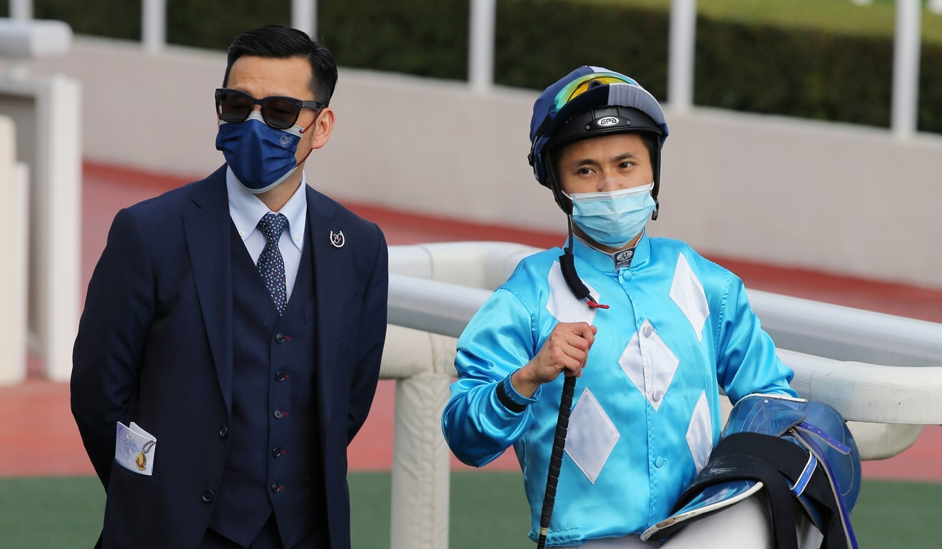 Trainer Frankie Lor and jockey Matthew Poon celebrate after All For St Paul's saluted at Sha Tin on Sunday.