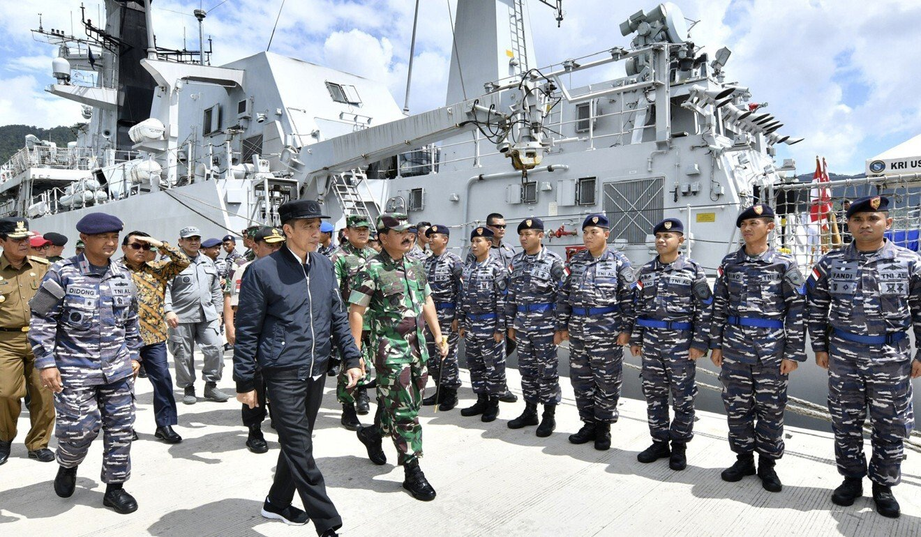 Indonesian President Joko Widodo inspects troops during his visit to the Natuna Islands in January 2020. Photo: AP