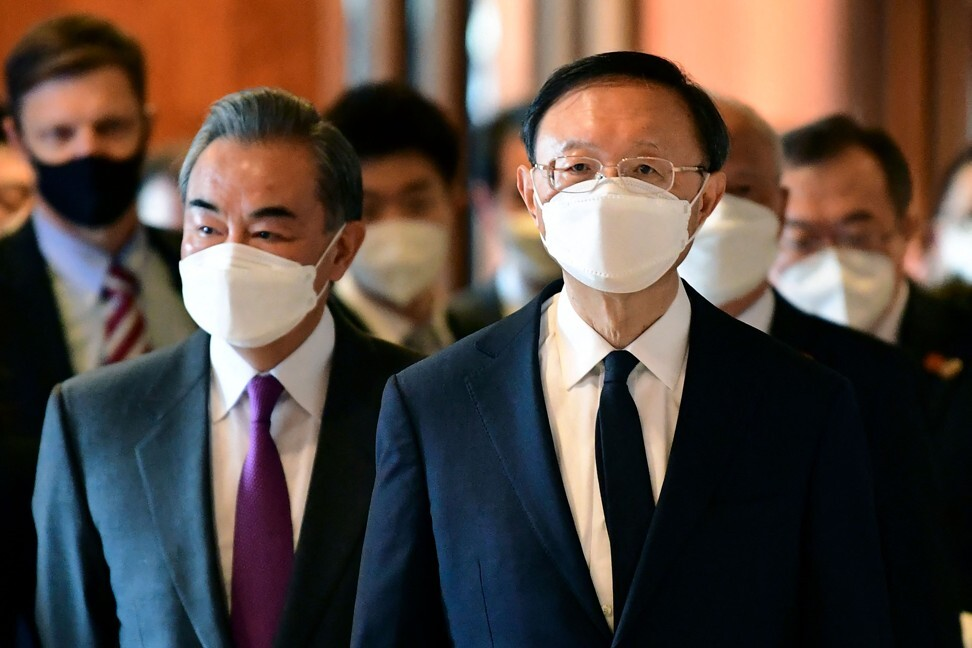 Wang Yi, left, and Yang Jiechi arrive at the opening session of the talks at the Captain Cook Hotel in Anchorage. Photo: Pool/AFP