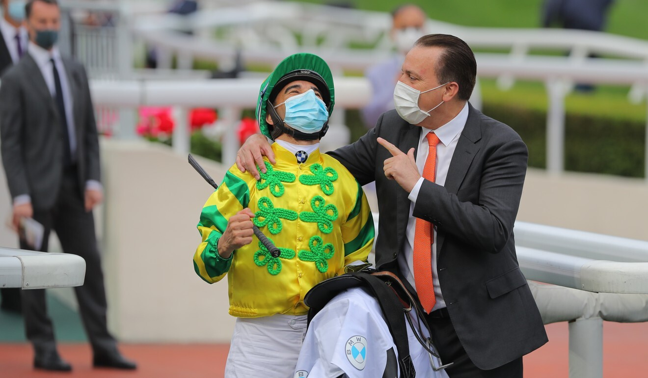 Joao Moreira and Caspar Fownes celebrate Sunday's Hong Kong Derby victory.