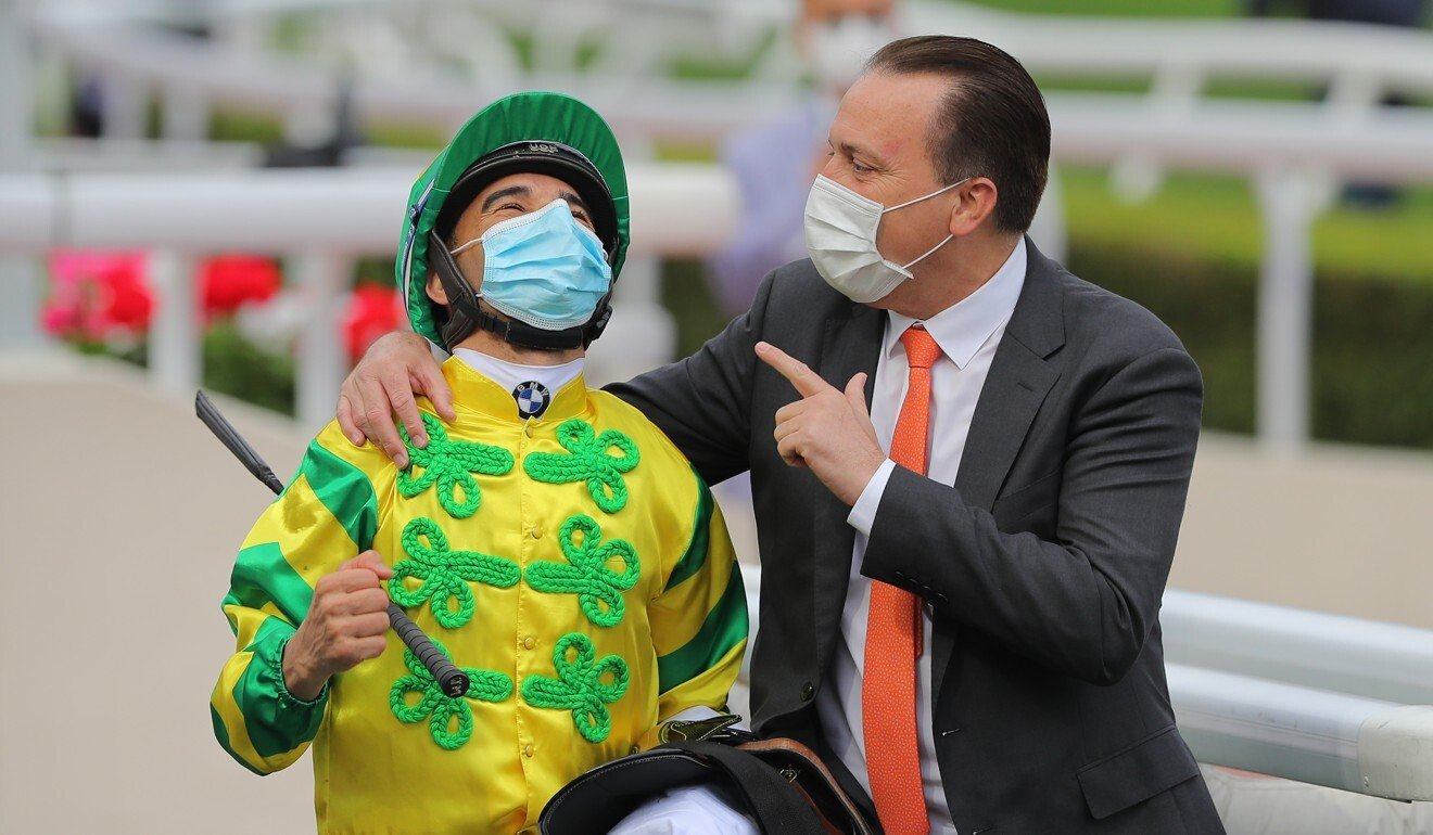 Joao Moreira and Caspar Fownes share a moment after the Sky Darci's win.