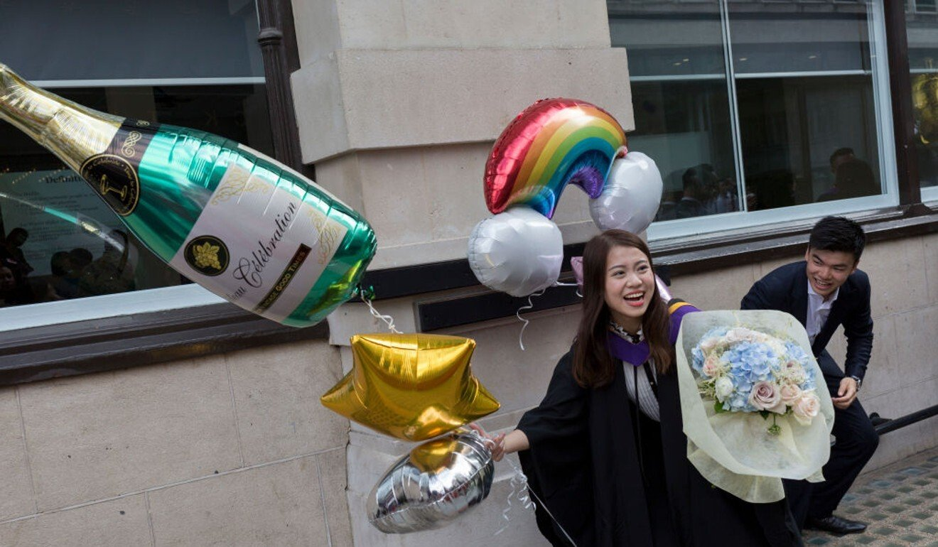 A 21-year-old law graduate from Hong Kong celebrates outside the London School of Economics in July 2019. Photo: Getty Images