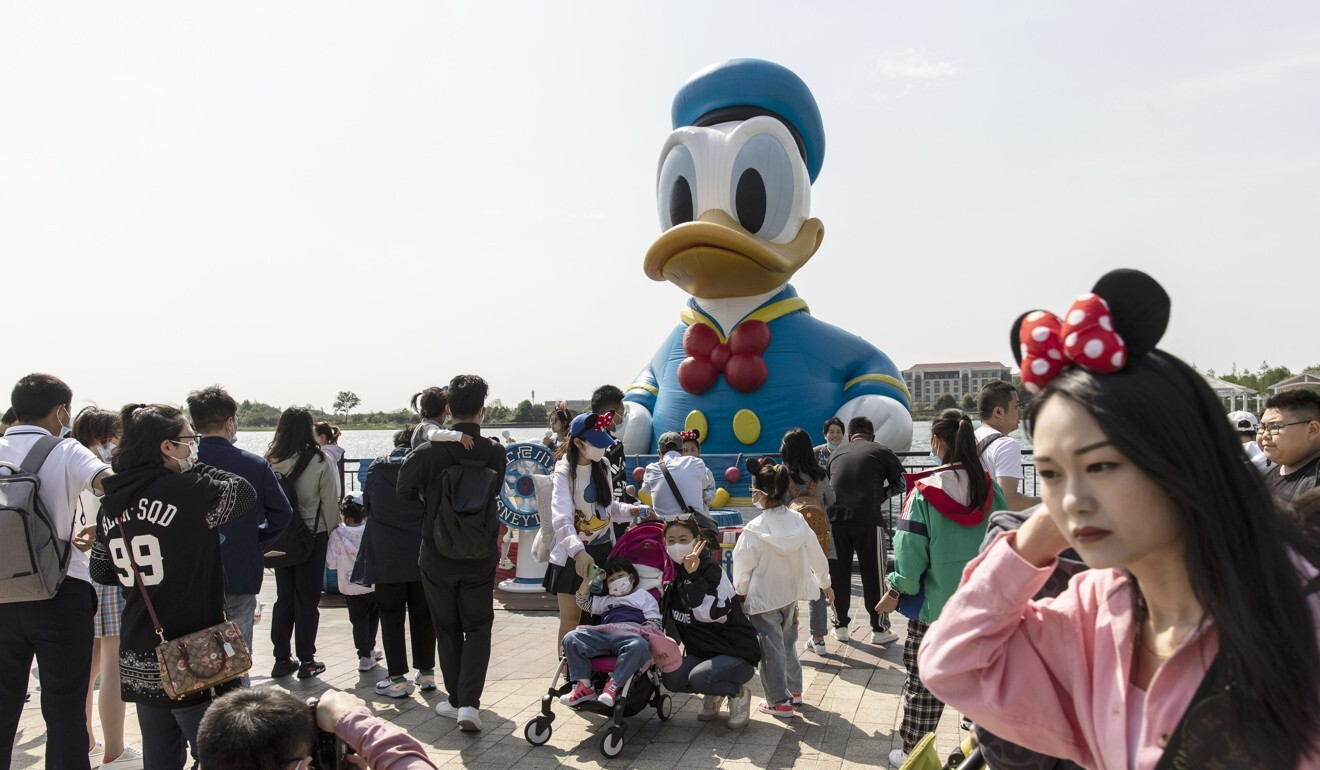 Visitors gather near a statue of Donald Duck outside Shanghai Disneyland. Photo: Bloomberg