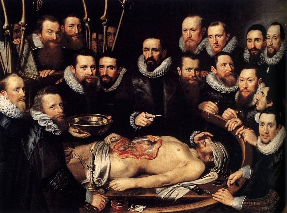 The Anatomy Lesson by Michiel and Peter van Mierevelt. An observer can be seen holding a pomander – a portable container for mixtures of aromatics to ward off infection.