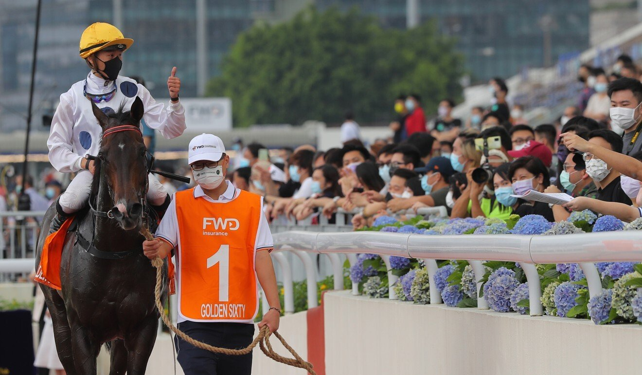 Vincent Ho gives fans the thumbs up after Golden Sixty's win in the Champions Mile.