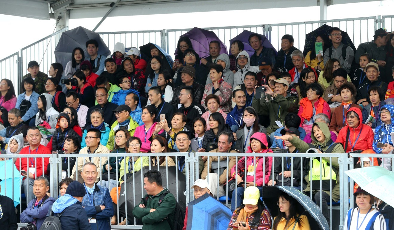 Chinese racing fans watch the Conghua races in 2019 from temporary stands.
