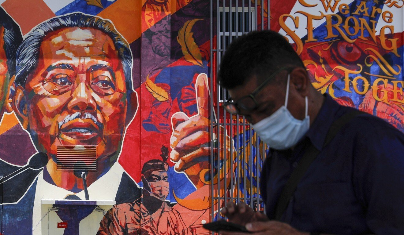 A mural at a government clinic in Kuala Lumpur depicts Malaysian Prime Minister Muhyiddin Yassin. Photo: EPA
