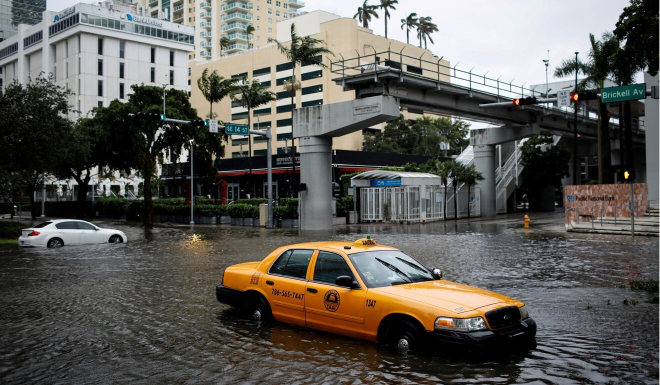 A damaged taxi is seen in floodwaters caused by Tropical Storm Eta in Miami, Florida in 2020. That year had more than 30 named tropical cyclones in the Atlantic – a record. Photo: Reuters