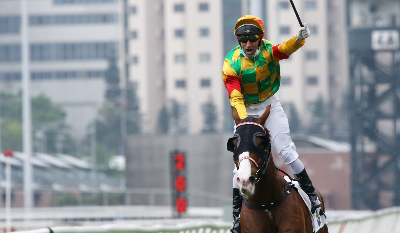 Neil Callan enjoys his win in the Group Two Chairman's Trophy aboard Mighty Giant on April 5.