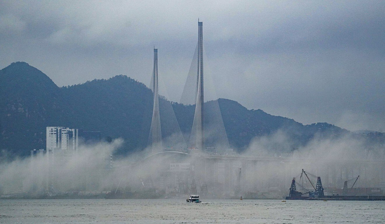 Smoke from the fire spreads across Victoria Harbour on Wednesday. Photo: Felix Wong
