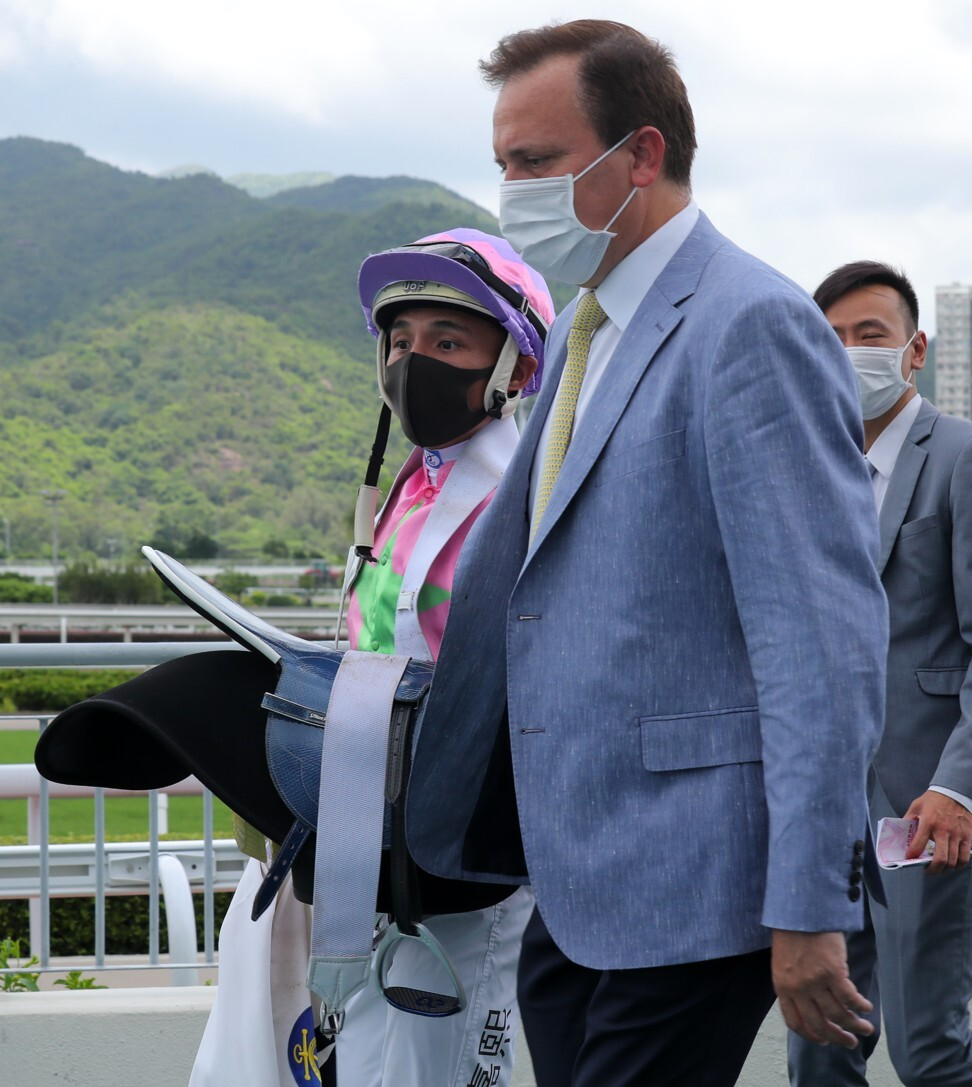 Jockey Alfred Chan and trainer Caspar Fownes discuss Joy Master's win.