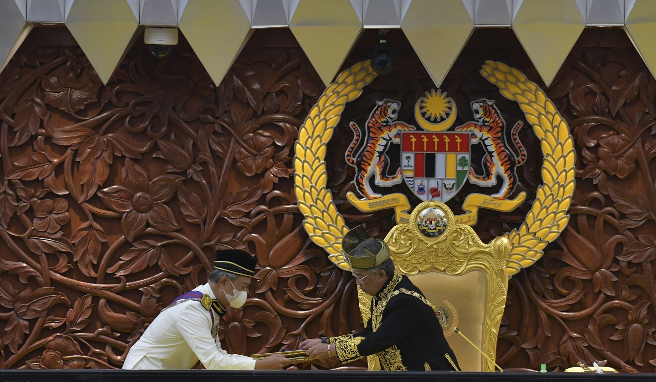 Malaysia's king, Sultan Abdullah Sultan Ahmad Shah (right) and Prime Minister Muhyiddin at the opening ceremony of a parliamentary session in 2020. Photo: AP