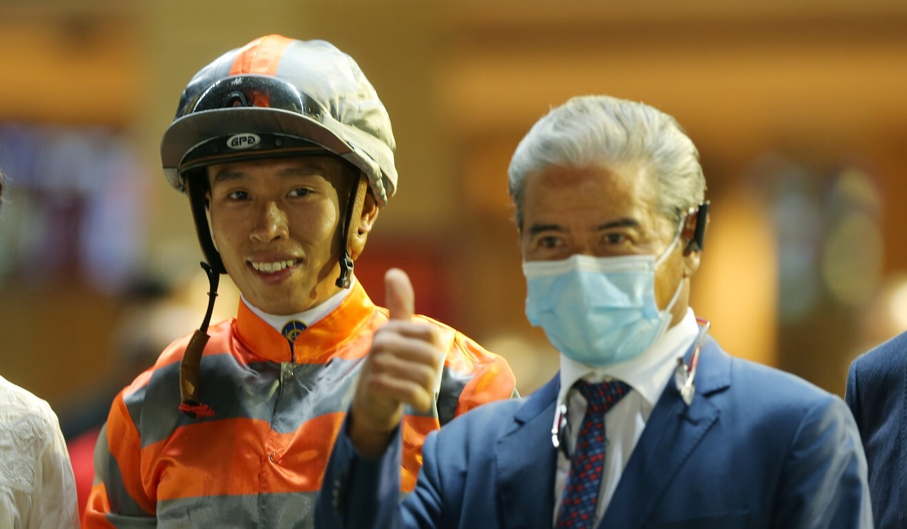 Vincent Ho (left) and Tony Cruz celebrate a winner.