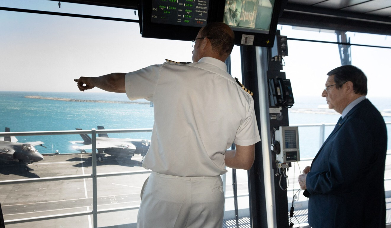 Cypriot President Nicos Anastasiades visited the HMS Queen Elizabeth while it was moored in the port of Limassol. Photo AFP/HO/PIO