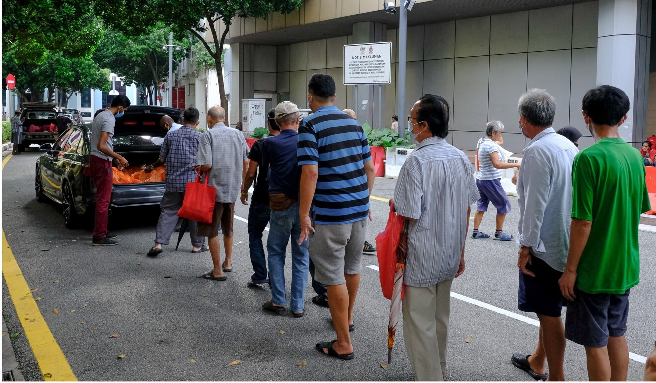 People stand in line to receive food donations in Kuala Lumpur. Photo: Bloomberg