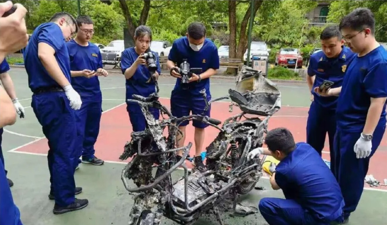 Investigators inspect the charred remains of an e-bike that exploded in China. Photo: Handout