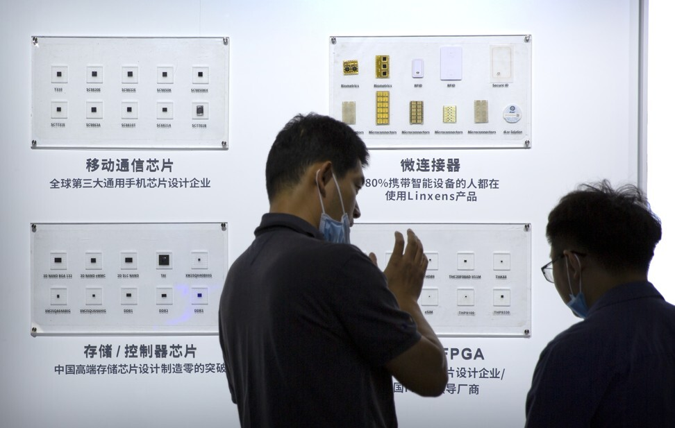 Visitors check out the semiconductor samples put on display by Tsinghua Unigroup at the China Beijing International High Tech Expo on September 19, 2020. Photo: AP
