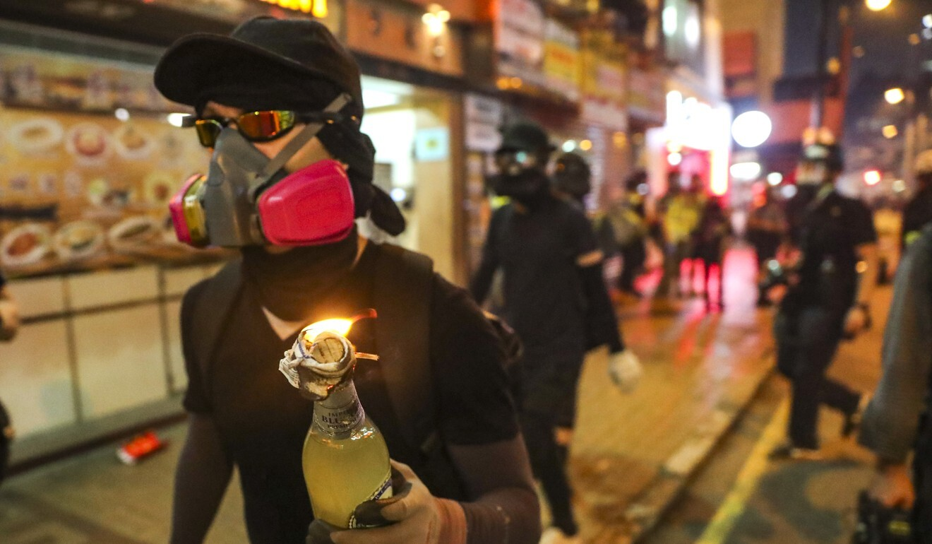 Protesters fuse petrol bombs to use as weapons during an anti-extradition bill march from Causeway Bay towards Wan Chai and Admiralty in 2019. Photo: Sam Tsang