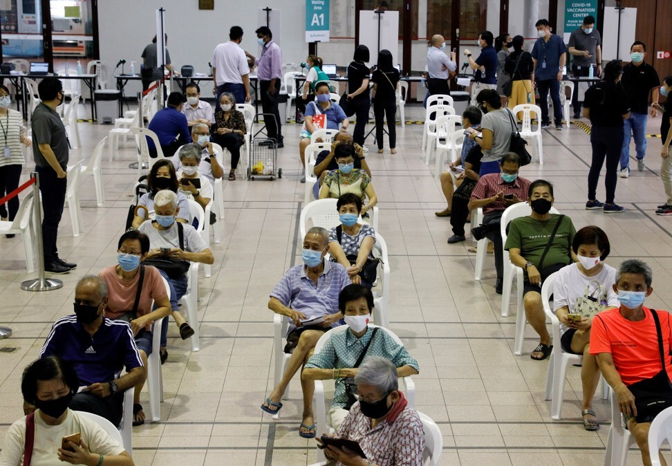 Seniors wait in an observation area after getting a Covid-19 vaccine dose. Photo: Reuters