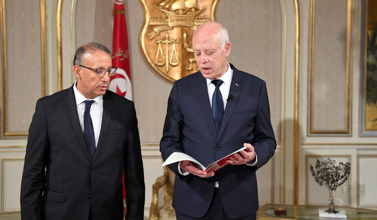 Tunisian President Kais Saied (right) with newly appointed acting Interior Minister Ridha Gharsallaoui. Photo: EPA
