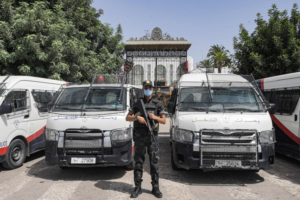 A member of Tunisia's security forces stands guard outside parliament in Tunis. Photo: AFP