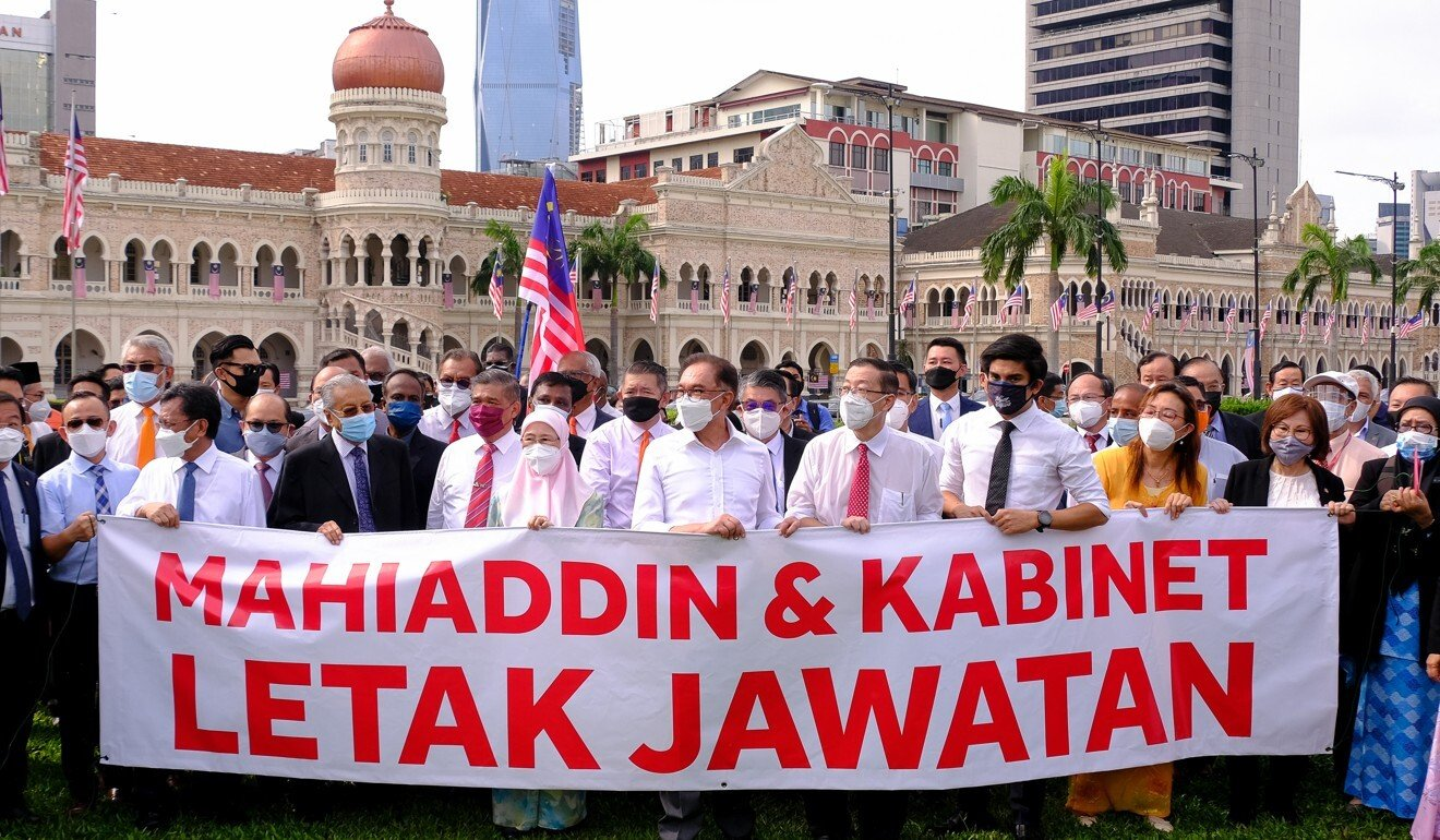 Opposition lawmakers at historic Dataran Merdeka call for the resignation of Muhyiddin and his cabinet. Photo: Bloomberg