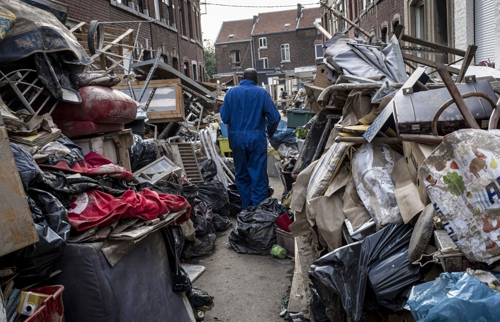 A man walks through piles of rubble in the aftermath of flooding in Belgium's Liege on July 19, 2021, after severe flooding in Germany and Belgium turned streams and streets into raging torrents that swept away cars and crashed into houses. Photo: AP