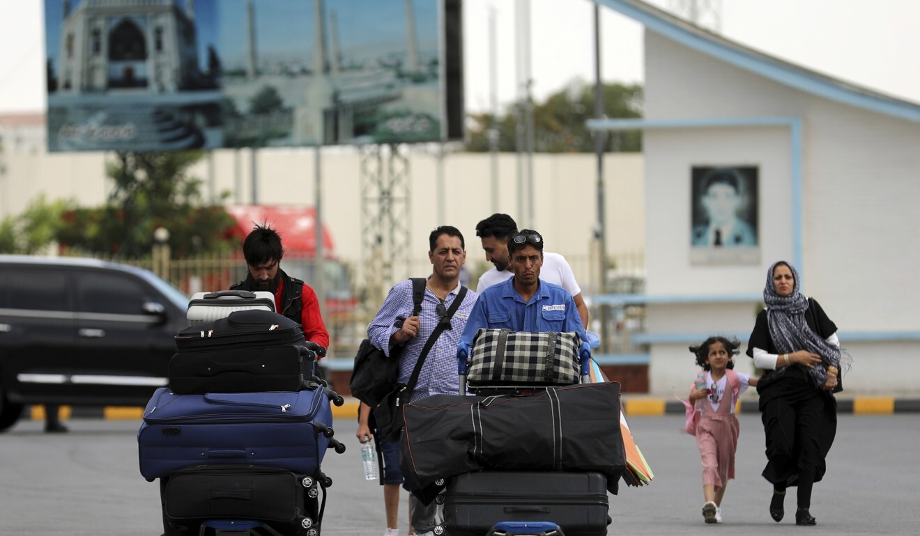 Passengers walk to the departures terminal of the airport in Kabul. Photo: AP