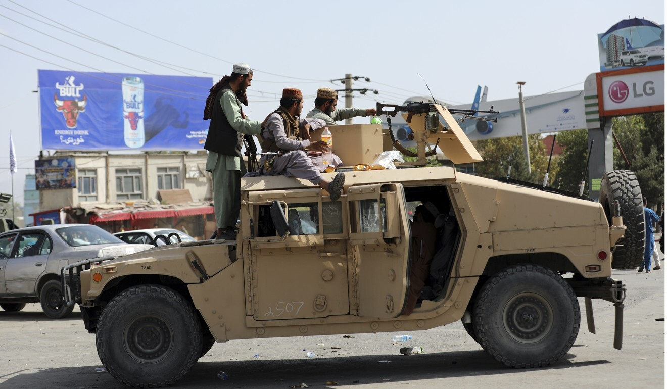 Taliban fighters in Kabul on a captured US-made Humvee. Photo: AP